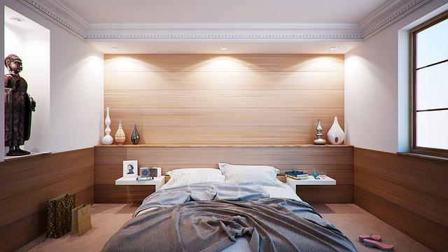 Chambre moderne d'appartement avec lit 2 places